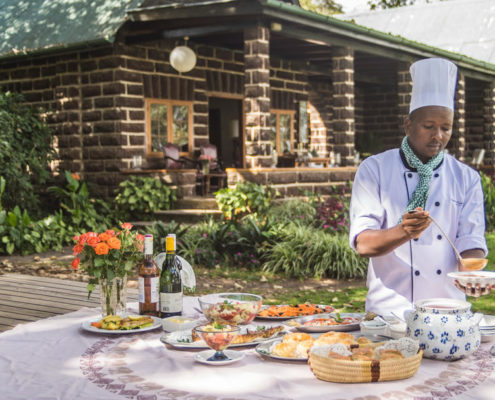 contains an image of a chef setting up breakfast at a B&B